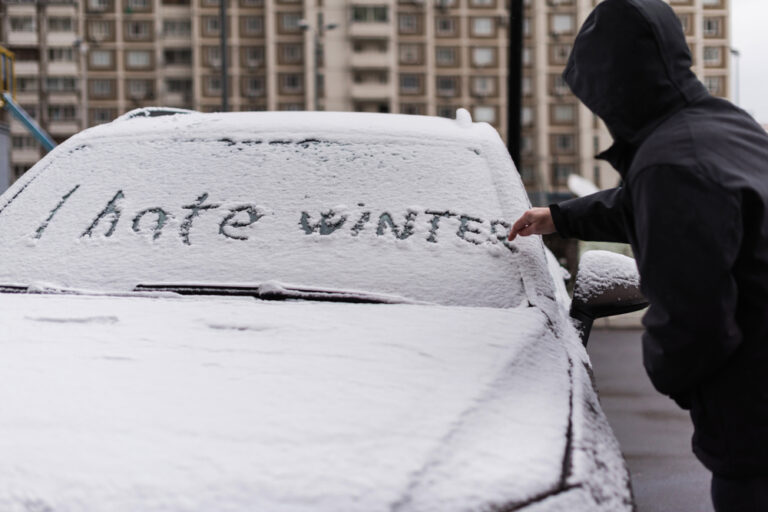 I hate winter written in snow.